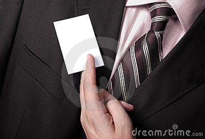 Businessman handing a blank business card