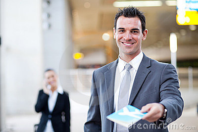 Businessman handing over air ticket