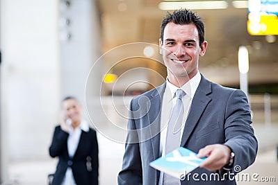 Businessman handing over air ticket