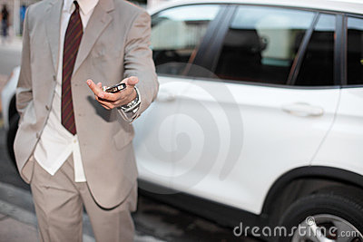 Businessman handing over the keys