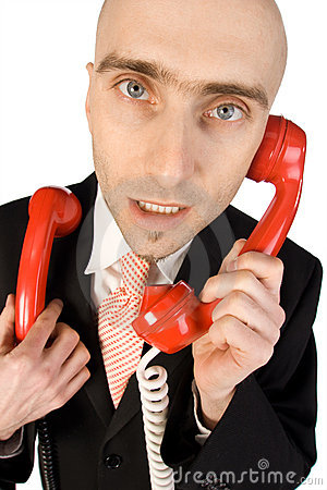 Businessman handling calls