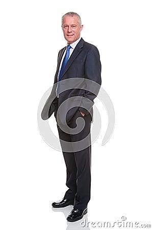 Businessman hands in pockets full length portrait