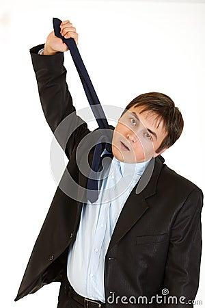 Businessman hanging himself on his necktie