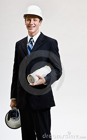 Businessman in hard-hat holding blueprints