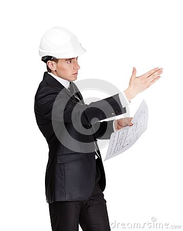 Businessman in hard hat pointing at something