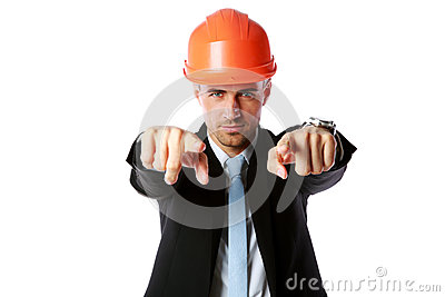 Businessman in hard hat pointing at you Stock Photo