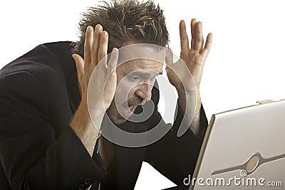 Businessman has Stress because of computer crash