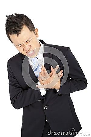 businessman having heart attack