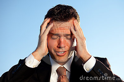 Businessman with a headache caused by stress