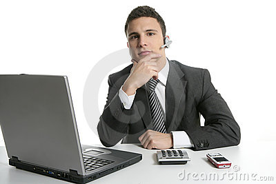 Businessman with headphones and laptop