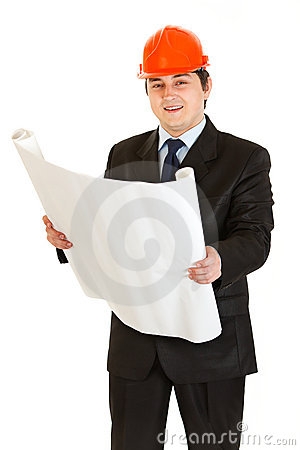 Businessman in helmet holding building plan