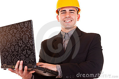 Businessman with helmet and laptop