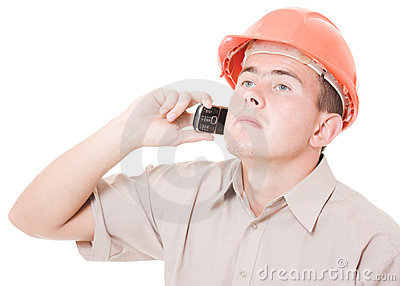 Businessman in helmet on the phone
