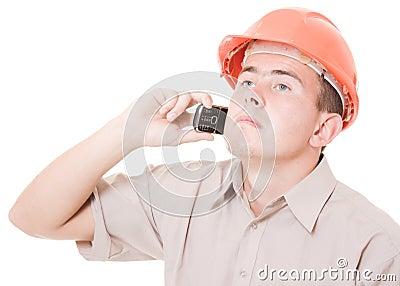 Businessman in helmet on the phone