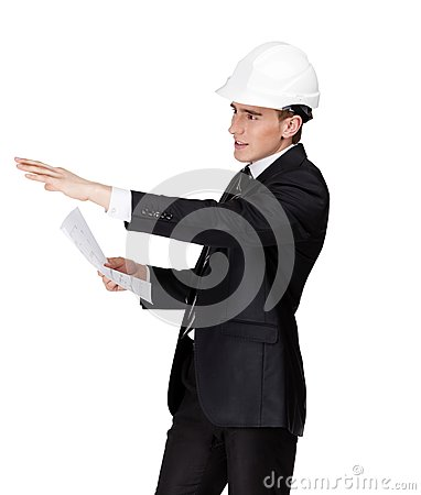 Businessman in helmet pointing at something