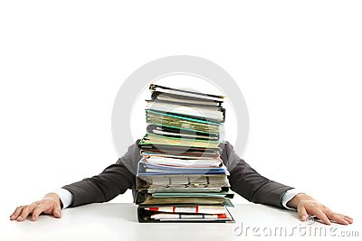 Businessman hiding behind paperwork