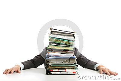 Businessman hiding behind paperwork