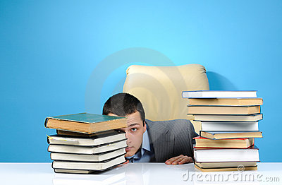 Businessman hiding in the books