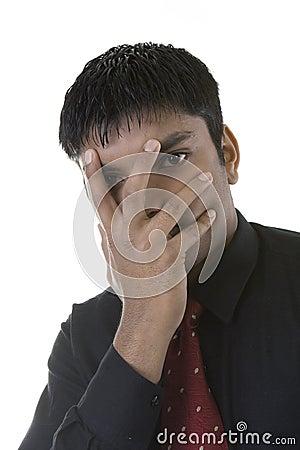 Businessman hiding face