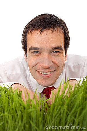 Businessman hiding in grass - isolated