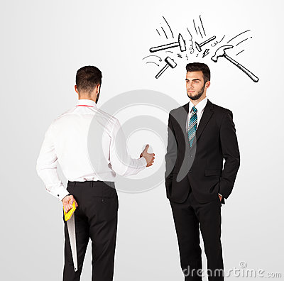 Businessman hiding a weapon Stock Photo