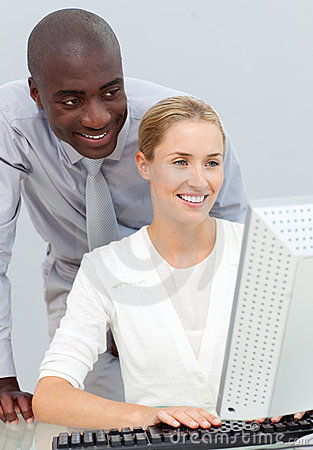 Businessman and his colleague at a computer
