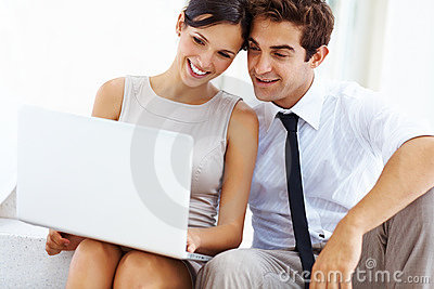 Businessman and his girlfriend using laptop