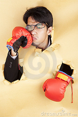 Businessman hit his face with boxing glove