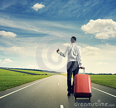 Free Businessman Hitch Hiking On The Road Royalty Free Stock Photos - 33470868