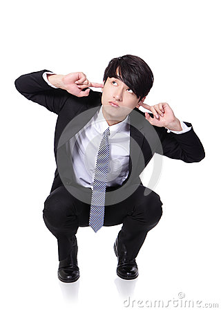 Businessman hold hands to cover ears
