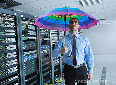 Businessman hold umbrella in server room