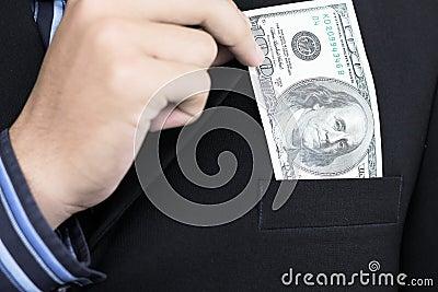Businessman holding 100 dollar