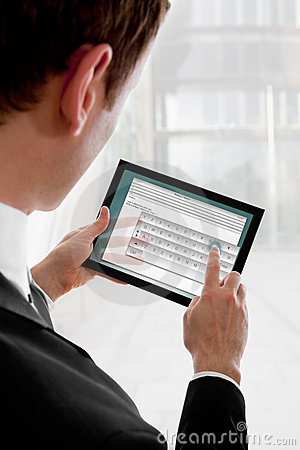 Free Businessman Holding A Touchpad Pc, Writing E-mail Royalty Free Stock Photo - 14109965