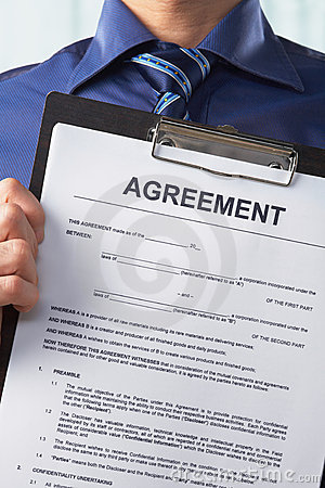 Businessman holding agreement paper