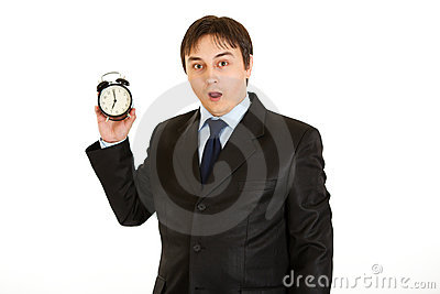 Businessman holding alarm clock. Lost time concept