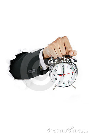 Businessman holding an alarmn clock