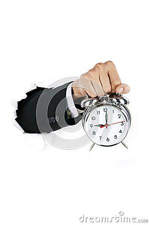 Businessman holding an alarmn clock