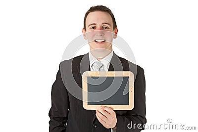 Businessman holding a black board