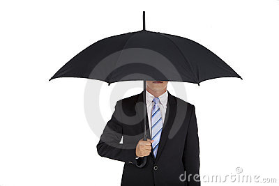 Businessman holding black umbrella