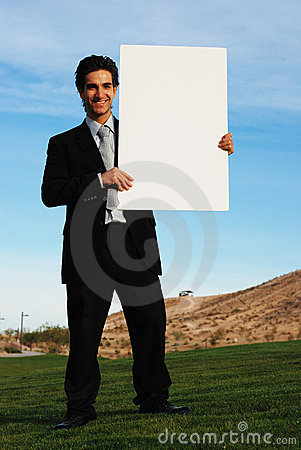 Businessman holding blank boar