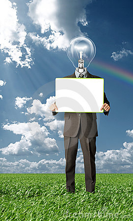 Businessman holding blank card outdoors