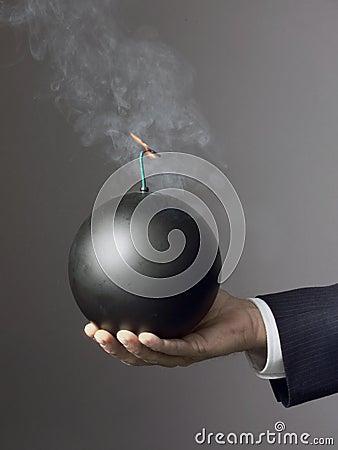Businessman holding bomb