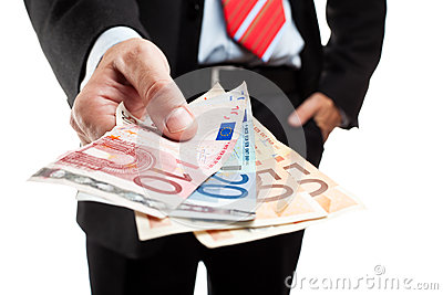 Businessman holding a bunch of money.
