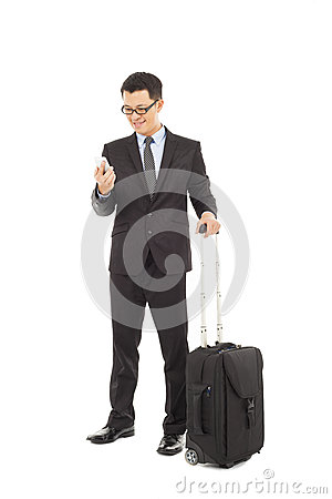 Businessman holding a cell phone  with briefcase