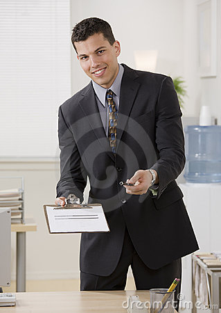 Businessman holding contract and pen