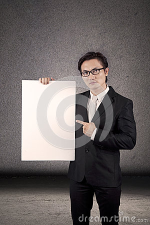 Businessman holding a copyspace