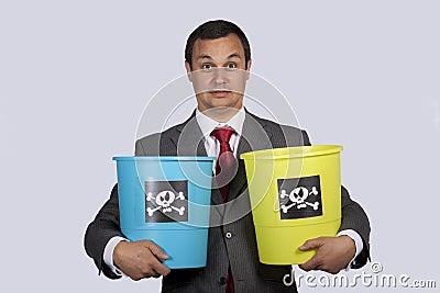 Businessman holding dangerouse buckets
