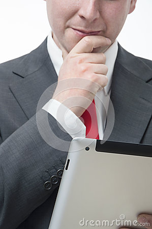 Businessman holding digital tablet