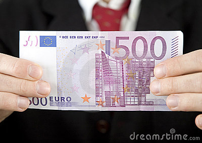 Businessman holding euro bill
