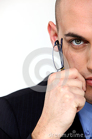 Businessman holding eyeglasses